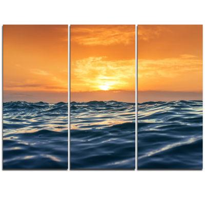 Designart Blue Waves Dancing At Yellow Sunset Beach Photo Triptych Canvas Print