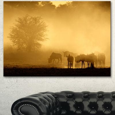 Designart Blue Wildebeest At Sunrise African Canvas Art Print - 3 Panels