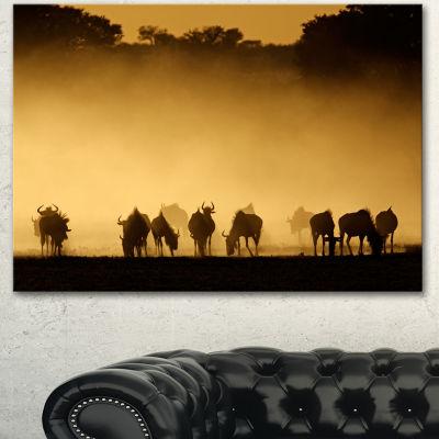 Designart Blue Wildebeest In Dust African Canvas Art Print - 3 Panels
