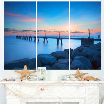 Designart Bluish Rocky Seashore With Pier Sea Bridge Triptych Canvas Art Print