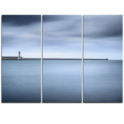 Designart Breakwater And Soft Water Under CloudsOversized Landscape Wall Art Print