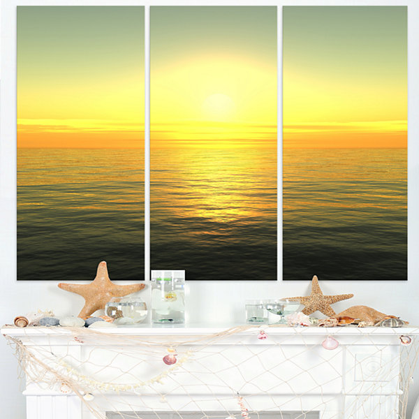 Designart Brilliant Yellow Sunrise Over Waters Beach Photo Triptych Canvas Print