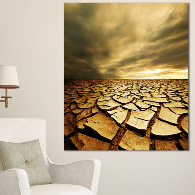 Designart Broken Drought Land With Dark Clouds African Landscape Canvas Art Print - 3 Panels