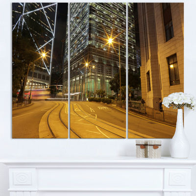 Designart Busy Traffic And City At Night CityscapeTriptych Canvas Art Print