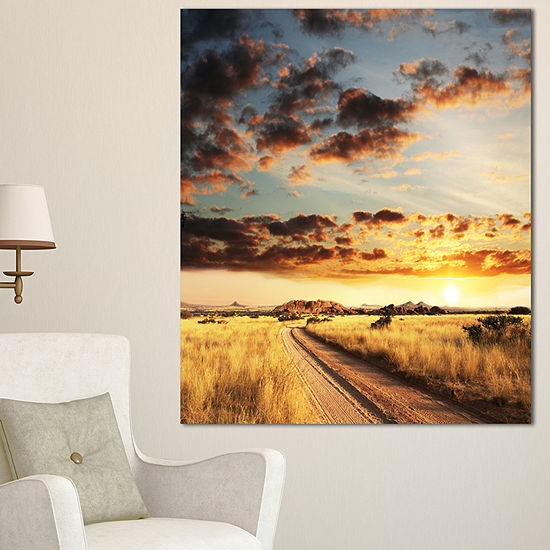 Designart Cloudy African Prairie With Pathway Extra Large Landscape Canvas Art - 3 Panels