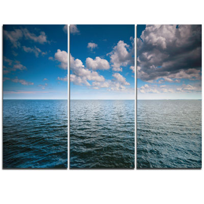 Designart Cloudy Blue Sky Above Sea Surface Oversized Beach Triptych Canvas Artwork