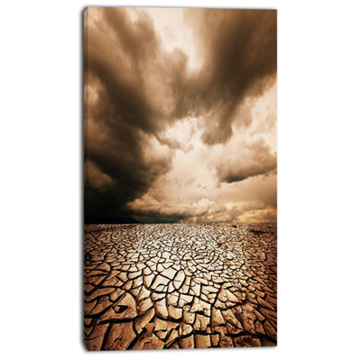 Designart Cracked Drought Land With Dark Clouds Oversized Landscape Canvas Art