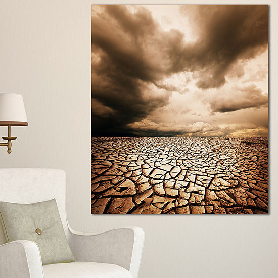 Designart Cracked Drought Land With Dark Clouds Oversized Landscape Canvas Art