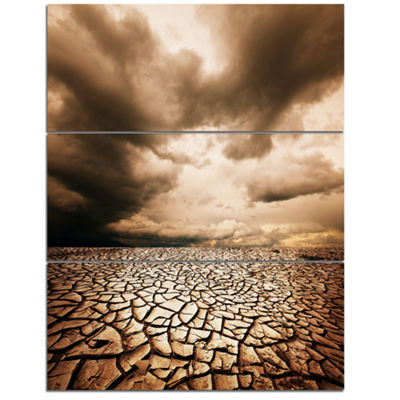 Designart Cracked Drought Land With Dark Clouds Oversized Landscape Canvas Art - 3 Panels