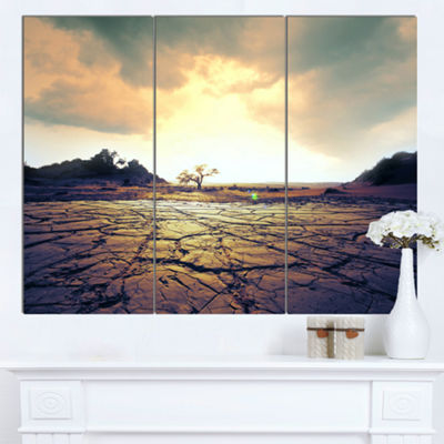 Designart Cracked Drought Land With Sunshine ExtraLarge Landscape Canvas Art - 3 Panels
