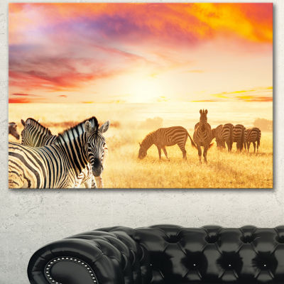 Designart Cute Zebras Grazing In Grassland AnimalCanvas Art Print