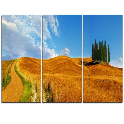 Designart Cypress Trees On Flowered Field Landscape Print Wall Artwork