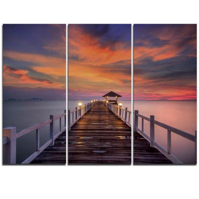 Designart Dark Seashore Pier Under Colorful Sky Pier Triptych Canvas Art Print