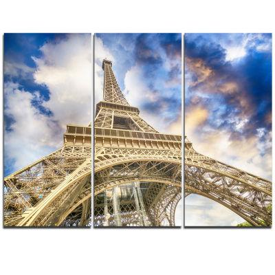 Designart Dramatic Sky Over Ground View Of ParisParis Eiffel Tower Cityscape Triptych Canvas Print