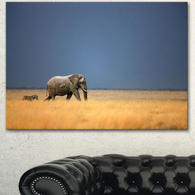 Designart Elephant And Zebra Walking In Bush African Canvas Art Print