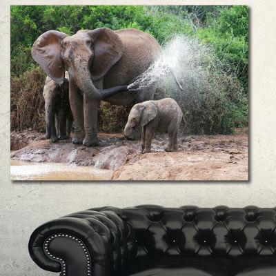 Designart Elephant Spraying Water African Canvas Art Print - 3 Panels