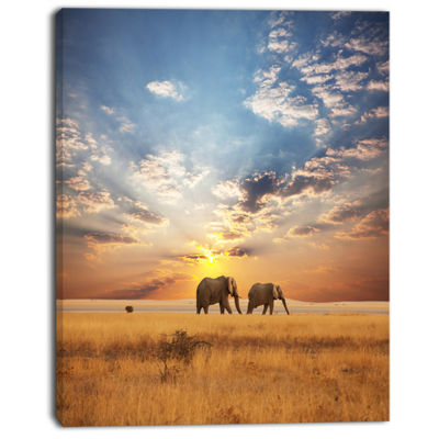 Designart Elephants Walking Along River Bank Animal Canvas Art Print