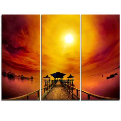 Designart Exotic Wood Pier Under Yellow Sun Sea Bridge Triptych Canvas Art Print
