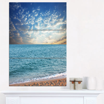 Designart Fasting Moving Clouds Over Blue Beach Modern Beach Triptych Canvas Art Print