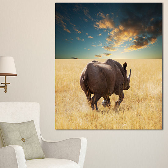 Designart Giant Rhino Under Cloudy Sky Extra LargeAfrican Canvas Art Print