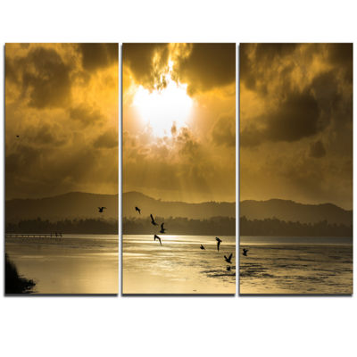 Designart Glittering Sun Among Heavy Clouds LargeSeashore Triptych Canvas Print