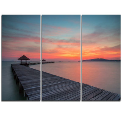 Designart Gloomy Seashore With Long Wood Pier PierTriptych Canvas Art Print