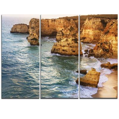 Designart Golden Rocks And Beach At Algarve ExtraLarge Seashore Triptych Canvas Art