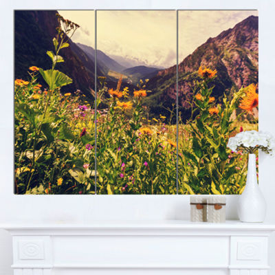 Designart Green Mountain Meadow With Flowers LargeFlower Canvas Wall Art - 3 Panels