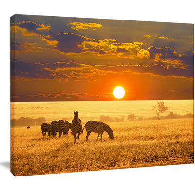 Designart Group Of Zebras Grazing At Sunset AnimalCanvas Art Print