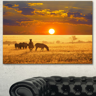 Designart Group Of Zebras Grazing At Sunset AnimalCanvas Art Print - 3 Panels