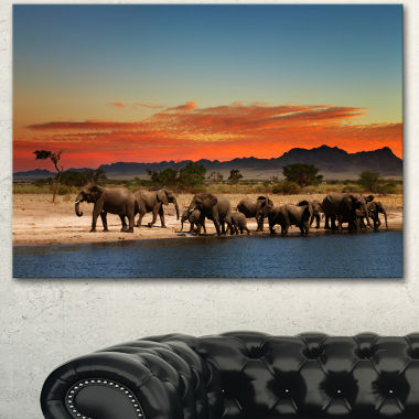 Designart Herd Of Elephants Watering In Savanna African Landscape Canvas Art Print