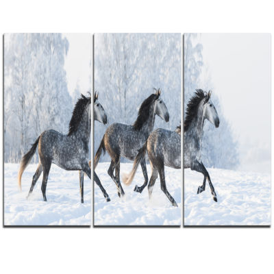 Designart Herd Of Horses Run Across Snow LandscapePrint Wall Artwork
