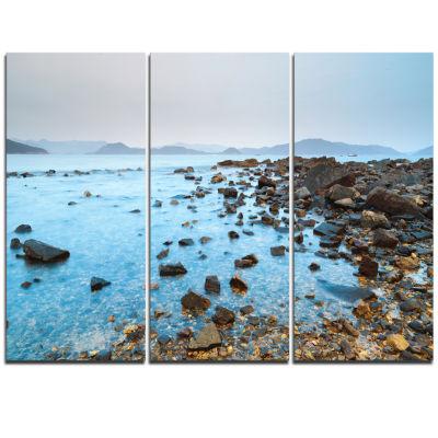 Designart Hong Kong Port Shelter Stony Beach LargeSeashore Triptych Canvas Print