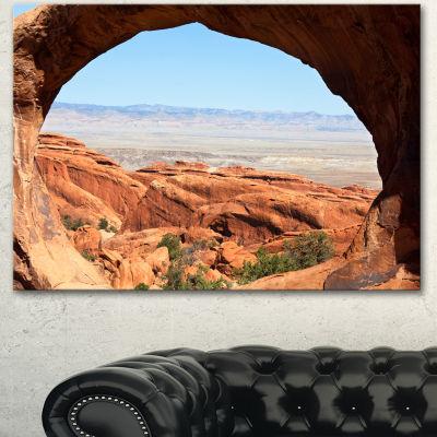 Designart Huge Arch Into Rocky Terrains LandscapeCanvas Art Print - 3 Panels