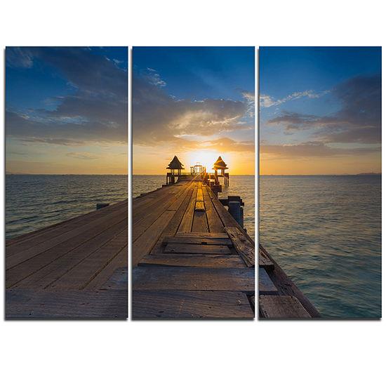 Designart Huge Wooden Pier Into Setting Sun PierSeascape Triptych Canvas Art Print