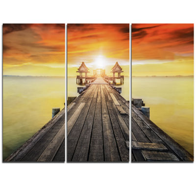 Designart Huge Wooden Pier Into Yellow Sun Pier Seascape Triptych Canvas Art Print