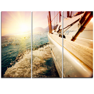 Designart Huge Yacht Sailing Against Sunset PierTriptych Canvas Art Print