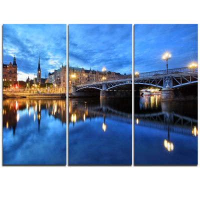 Designart Illuminated Blue Stockholm Cityscape Triptych Canvas Print