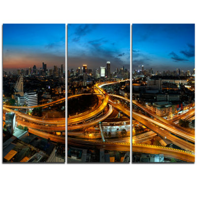 Designart Illuminated Highway In Bangkok CityscapeTriptych Canvas Print