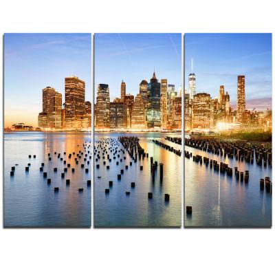 Designart Illuminated New York Skyscrapers Cityscape Triptych Canvas Print