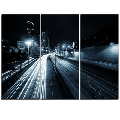 Designart Illuminated Traffic Trail In Downtown Seattle Cityscape Triptych Canvas Print