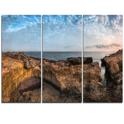 Designart Rough Rocky Coast Under Blue Sky Oversized Beach Triptych Canvas Artwork