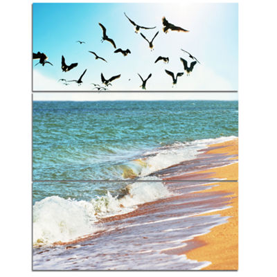 Designart Sea Gulls Over The Seashore Seashore Canvas Art Print - 3 Panels