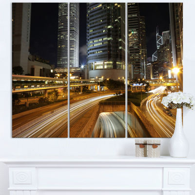 Designart Skyscrapers And Busy Traffic CityscapeTriptych Canvas Art Print