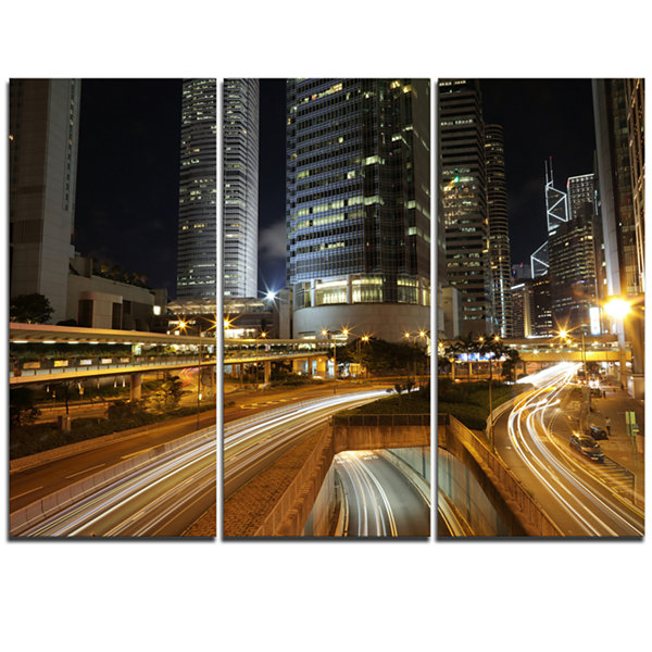 Design Art Skyscrapers And Busy Traffic CityscapeTriptych Canvas Art Print