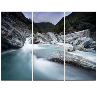 Designart Slow Motion Mountain River In Blue LargeSeashore Triptych Canvas Print