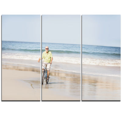Designart Smiling Senior Man Riding Bike LandscapeTriptych Canvas Art Print