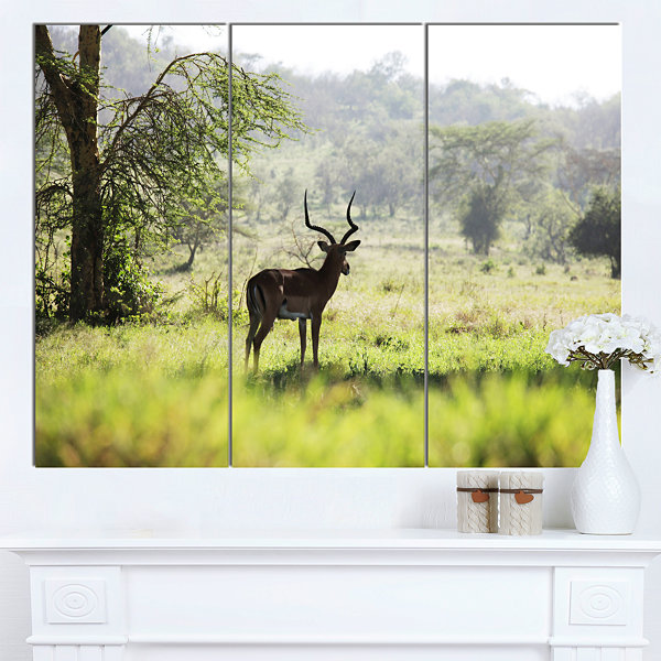 Designart Solitary Antelope In Green Park AfricanLandscape Canvas Art Print - 3 Panels