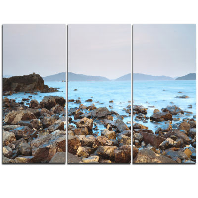 Designart Stones On Shore Of Port Shelter Hk LargeSeashore Triptych Canvas Print