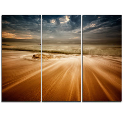 Designart Stormy Sea With Waves Flowing Out BeachPhoto Triptych Canvas Print